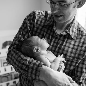 17 best family photographer London baby looking up to dad