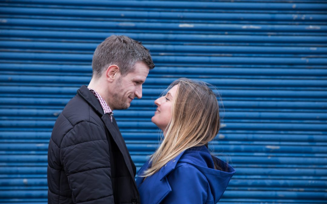 couple by blue metal shutters engagement photographer London